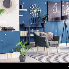 Blue Green Chair Cheap Covers For Sale Plant On Cupboard In Cozy Living Room Interior With Armchair Striped Carpet