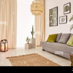 Grey Sofa Living Room Carpet Furniture Decor Ideas Light With Green Pillows And Window Stock