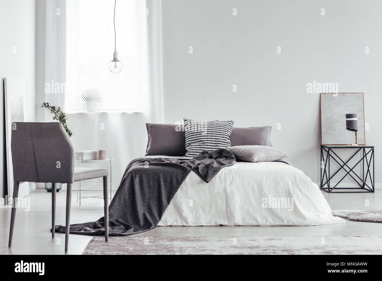 bedroom chair with blanket buy dining covers australia grey and bed patterned cushions in white interior lamp on table against a wall copy space