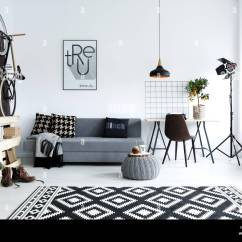 Living Room With Carpet Extra Large Chairs Hipster Style White Sofa Pouf Bike Stock