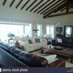 White Sofa Living Room Apartment Decorating Ideas On A Budget Brown Leather Sofas And In Modern Coastal With Indonesian Wood Coffee Table Beamed Apex Ceiling