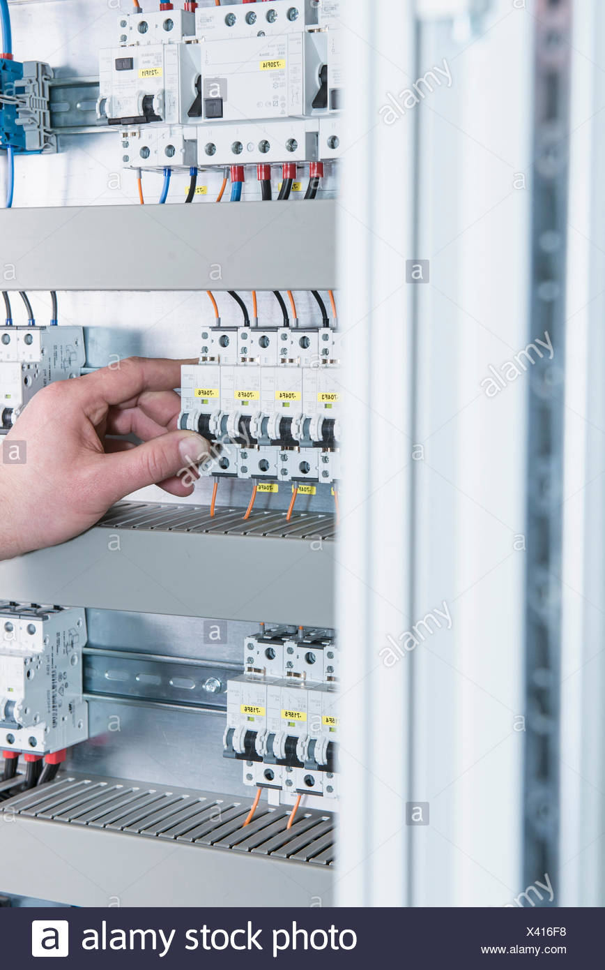 hight resolution of close up of electrician switching electrical fuse in distribution fusebox munich bavaria germany