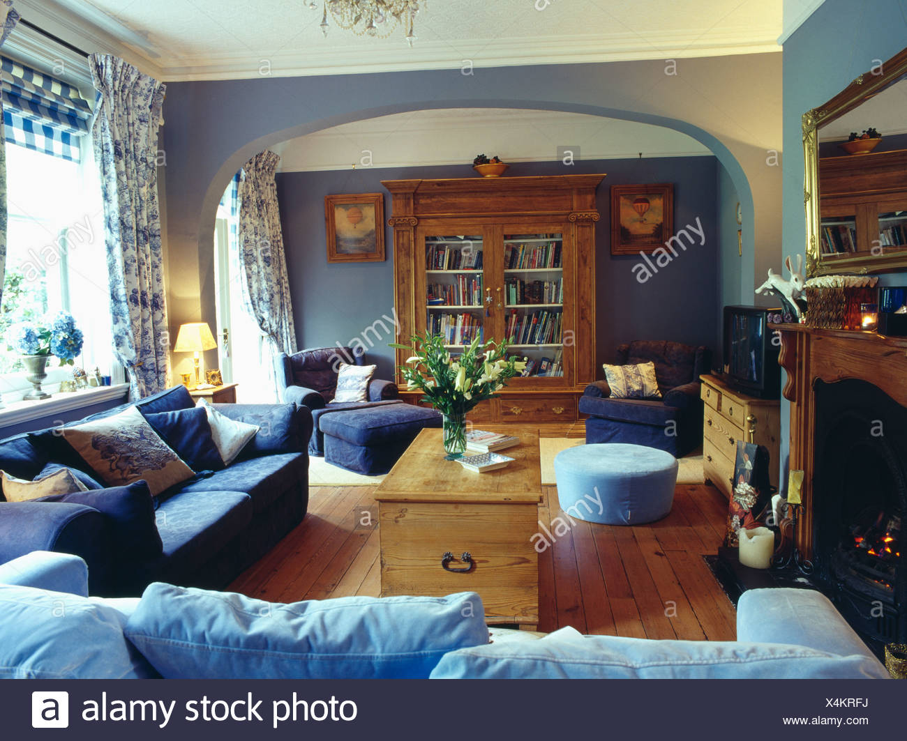 sofas dark blue light grey leather sofa pale and pine chest in living room with floral curtains wooden floor large cupboard