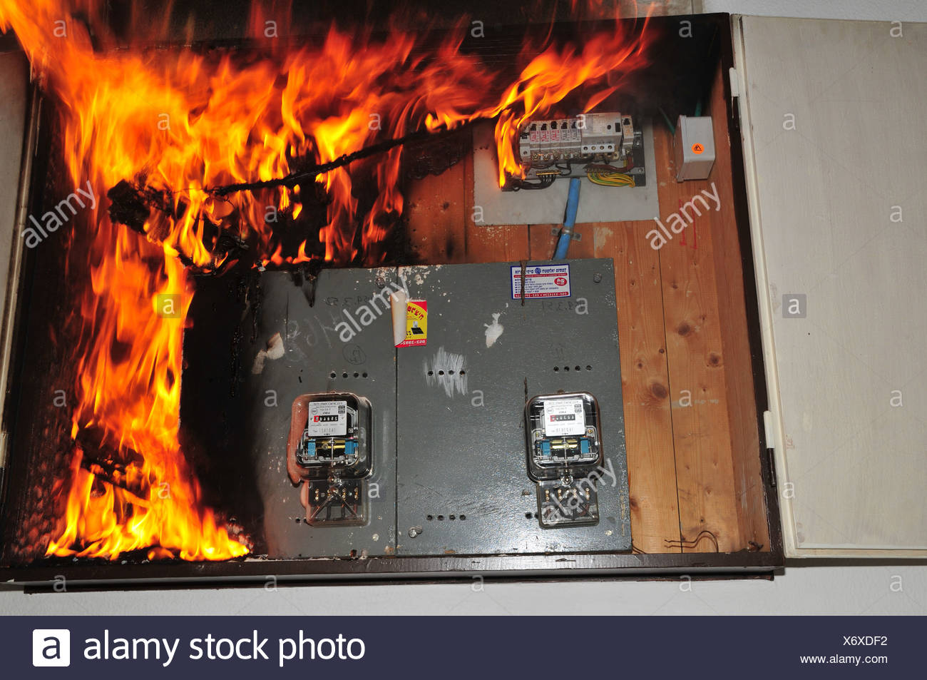 hight resolution of a fire broke out in a household electrical fuse box flames consumed the board photographed