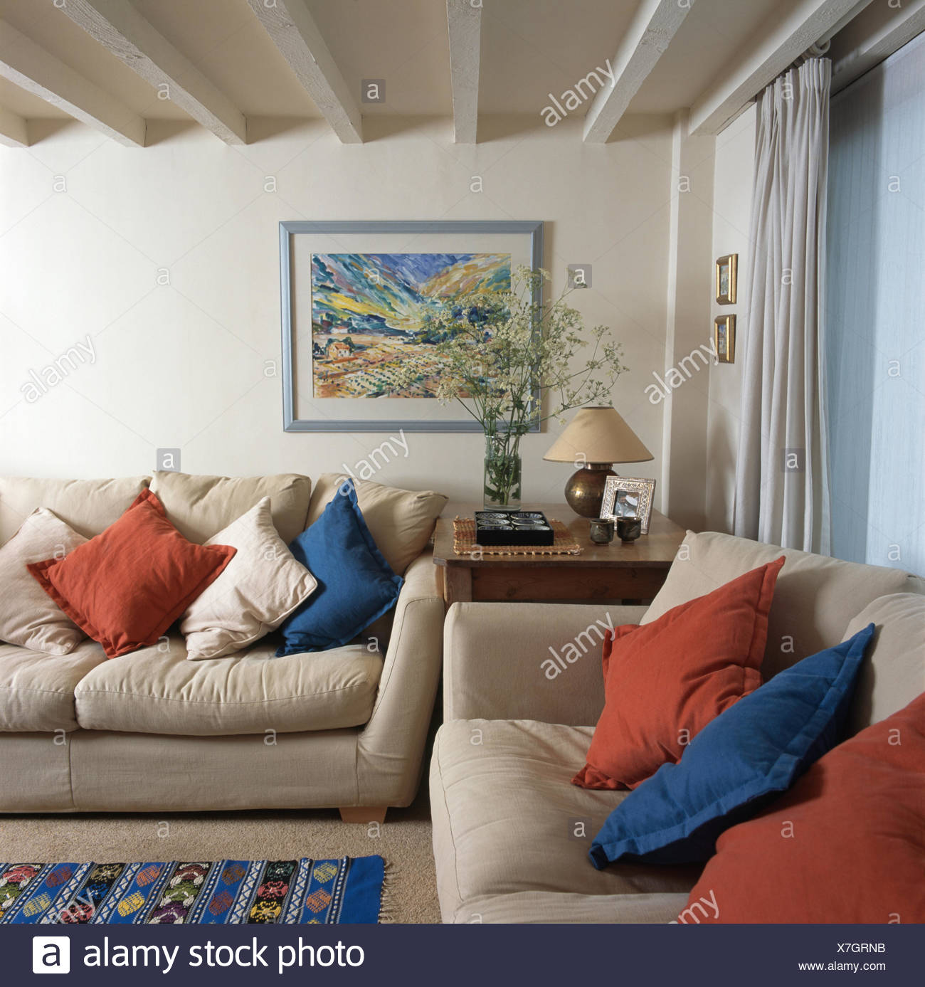 living room cushions chocolate sofa ideas blue and red on cream sofas in a traditional with lime washed beamed ceiling