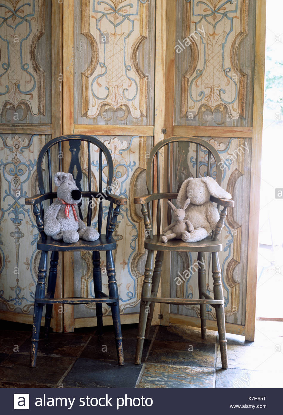 childrens chairs soft summer infant bentwood high chair close up of toy dog and rabbit on children s windsor against painted wooden screen
