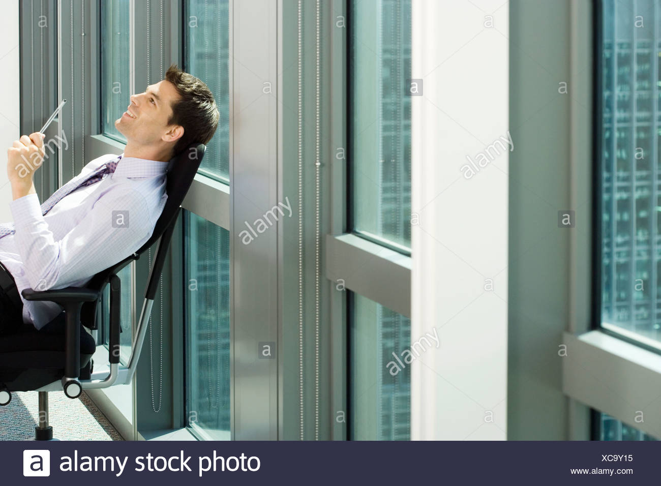 office chair leaning to one side how cane a back profile stock photos and images alamy
