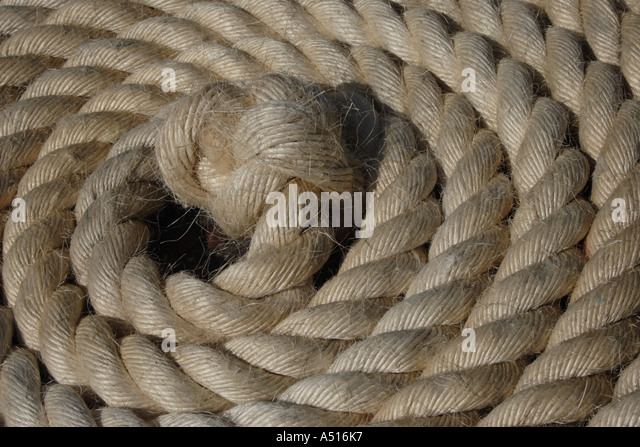 Coil of rope lies in ever-decreasing circles - Stock Image