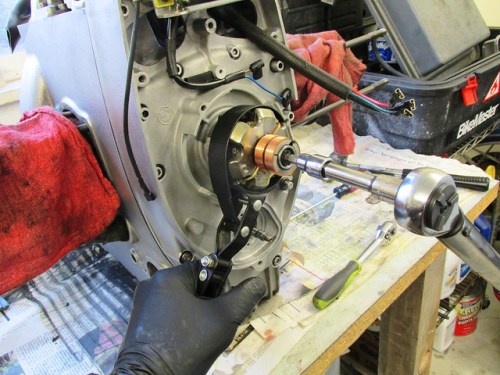Torquing Alternator Rotor Bolt to 14 FT-Lbs With Oil Filter Wrench To Hold Rotor