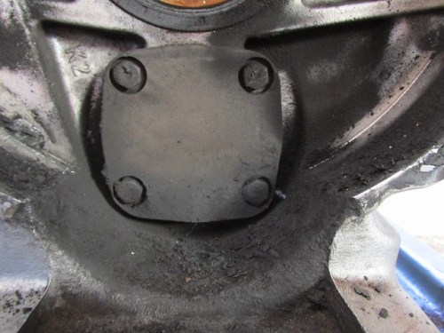 Newer Oil Pump Cover with Hex Head Bolts and Evidence of Leaking
