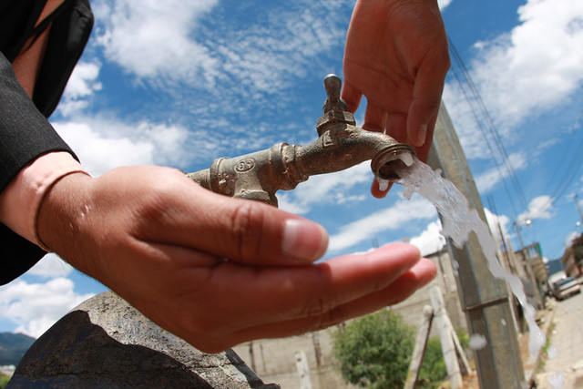 Drinking water at a street-side water tap