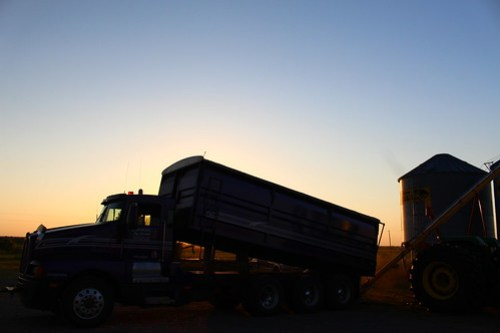 Purple unloading some seed for Farmer Mike.