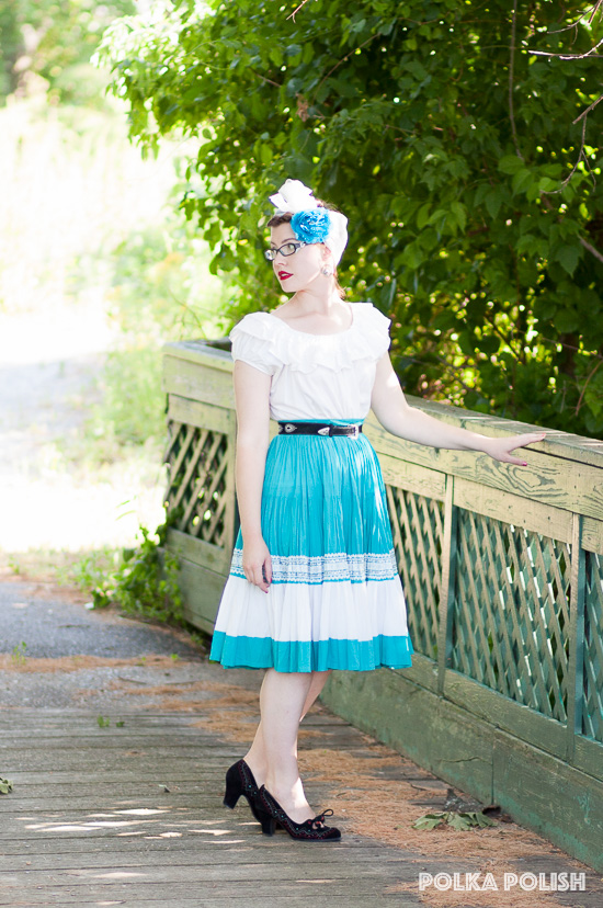 A vintage blue and white patio skirt paired with a white peasant top is the perfect combo for steamy summer days