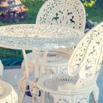 Vintage Wrought Iron Garden Table And Chairs In A Garden Stock Photo Alamy