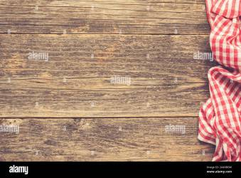 Wooden table with checkered textile Food menu background pizza or picnic concept Rustic wooden planks and red plaid textile Copy space Stock Photo Alamy