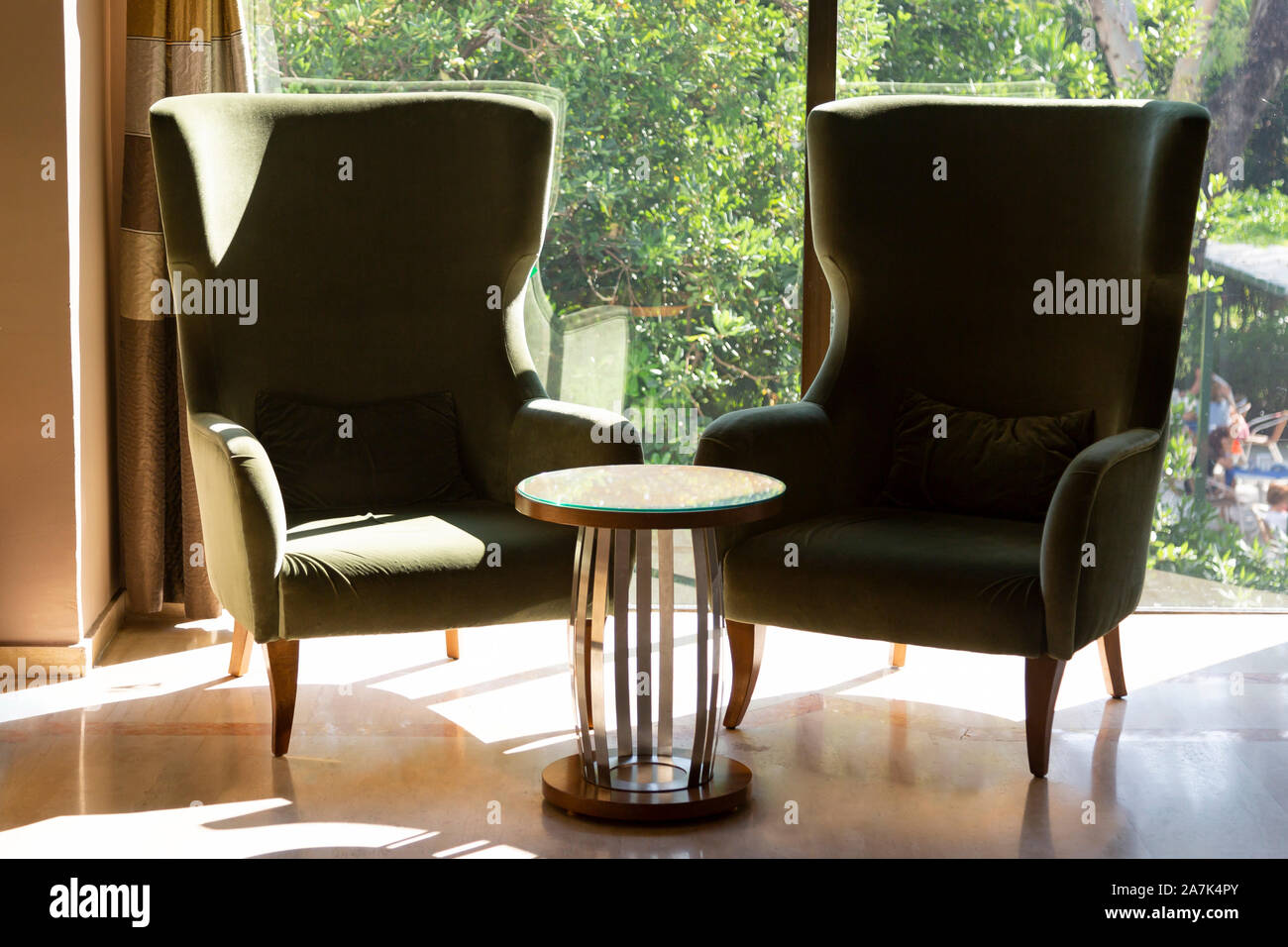 https www alamy com two chairs with green velvet and a coffee table image331720451 html