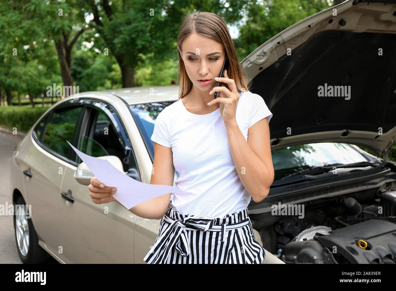 Woman Calling Her Insurance Agent While Standing Near Broken Car On Road Stock Photo Alamy