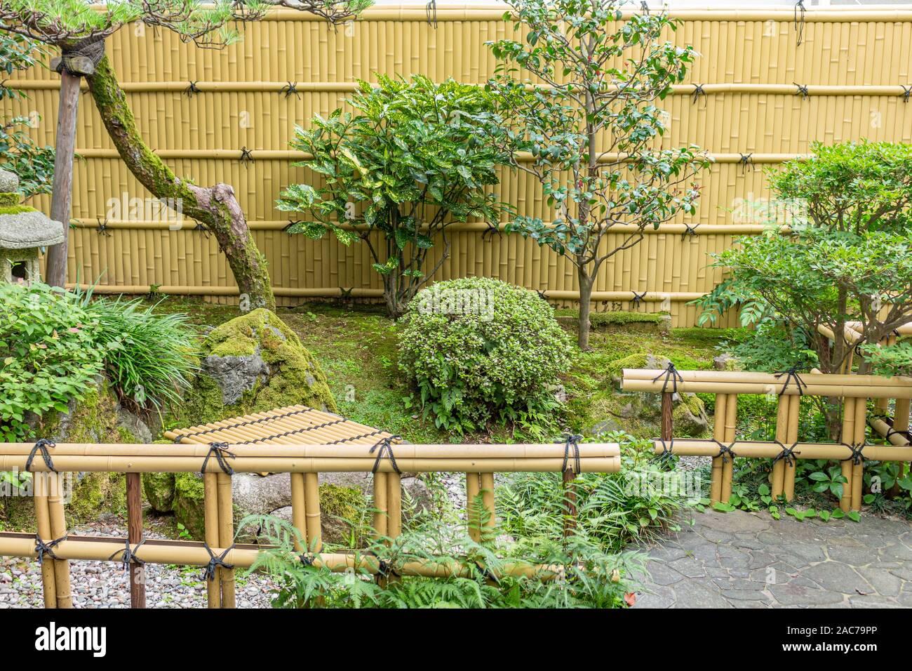 Summer View Of Traditional Small Japanese Garden With Bamboo And Stone Lantern Kanazawa City Ishikawa Prefecture Japan Stock Photo Alamy