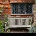Leaded Cross Pattern Window In Brick And Tile Wall With Bench Seat Under Sussex England Stock Photo Alamy