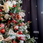 Modern Christmas Tree Decorated With Vintage Ornaments Ratan Balls Burlap And Tartan Ribbons Wooden Snowflakes Red Berries And Balls Red White B Stock Photo Alamy