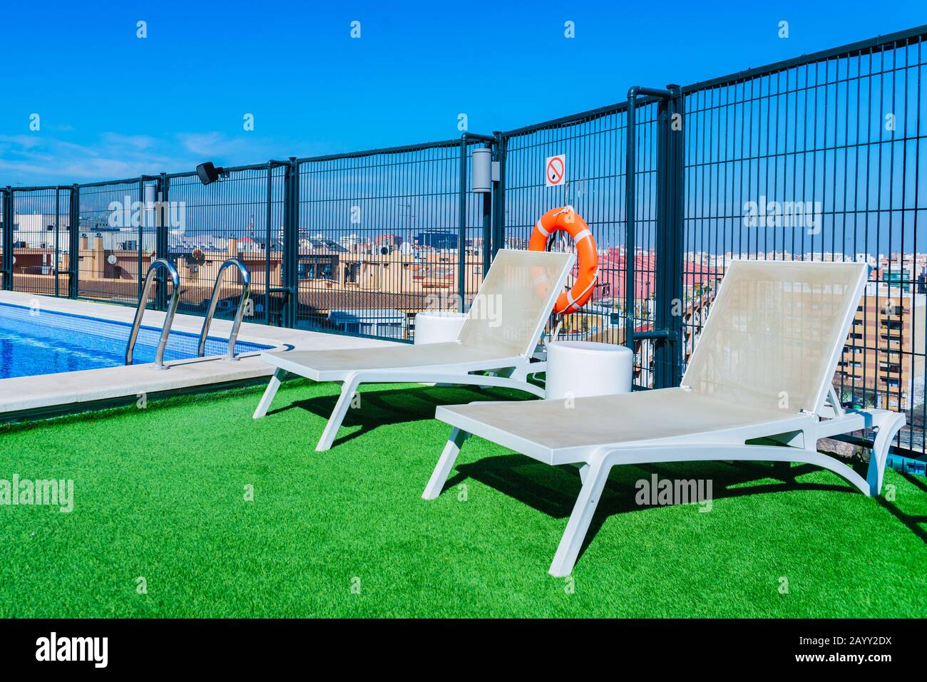 A Swimming Pool With Sun Beds On The Roof Of A Building In The City Stock Photo Alamy