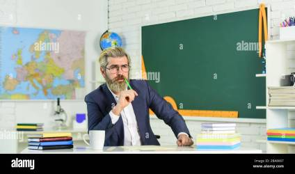 Teacher bearded man chalkboard background Teacher work Lecturer in classroom College high school Final examination may be oral written or practical Teacher explaining theory Prepare for test Stock Photo Alamy