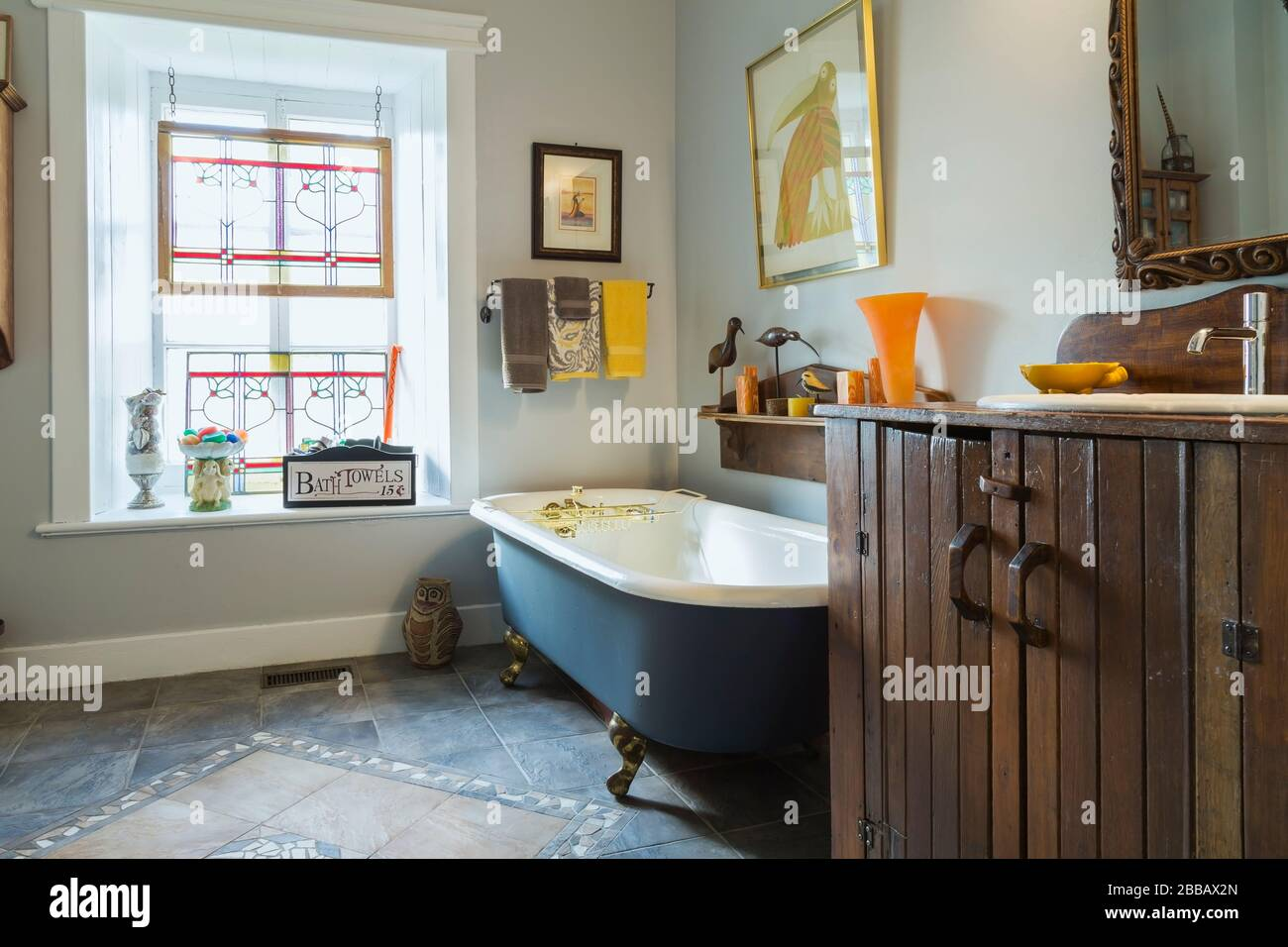 https www alamy com main bathroom with freestanding claw foot bathtub ceramic tile floor and window decorated with suspended stained glass frames inside an old circa 1830 quebecois style country home quebec canada this image is property released cupr0357 image351208557 html