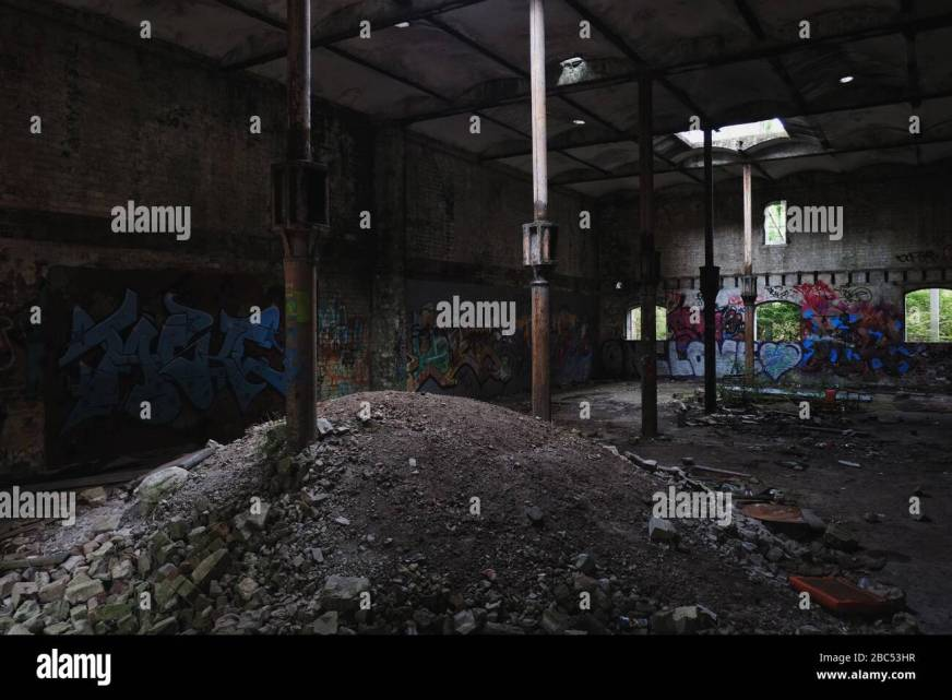 Ground Floor Interior With Cast Iron Columns Dirt Pile Window Light Graffiti Walls The Maltings Abandoned Industrial Site Mittagong Nsw Stock Photo Alamy