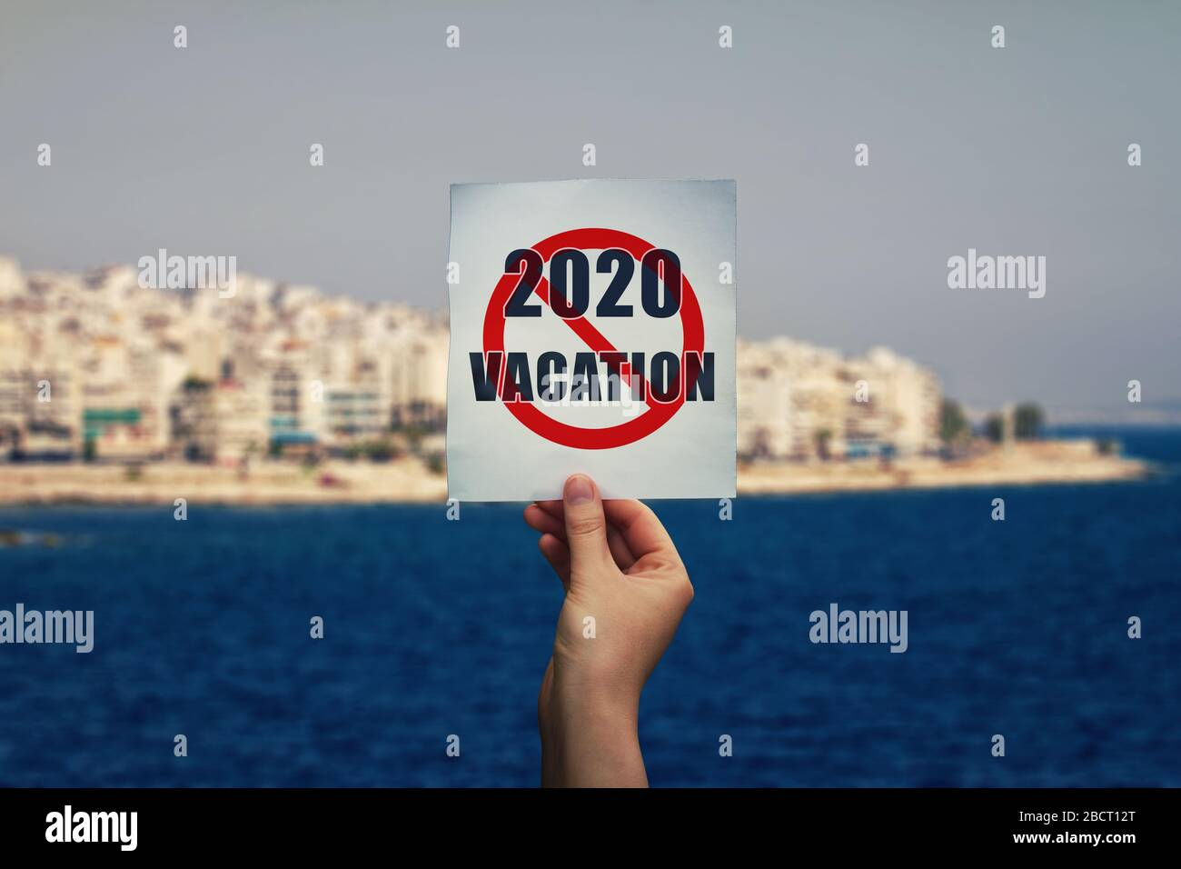Hand Holds A Text Message On 2020 Cancelled Summer Vacation Over An Exotic Seashore Background Holiday Concept Delayed Travel And Home Isolation Due Stock Photo Alamy