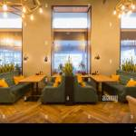 Restaurant In Modern Style Light Colors Interior With Green Sofas Stock Photo Alamy