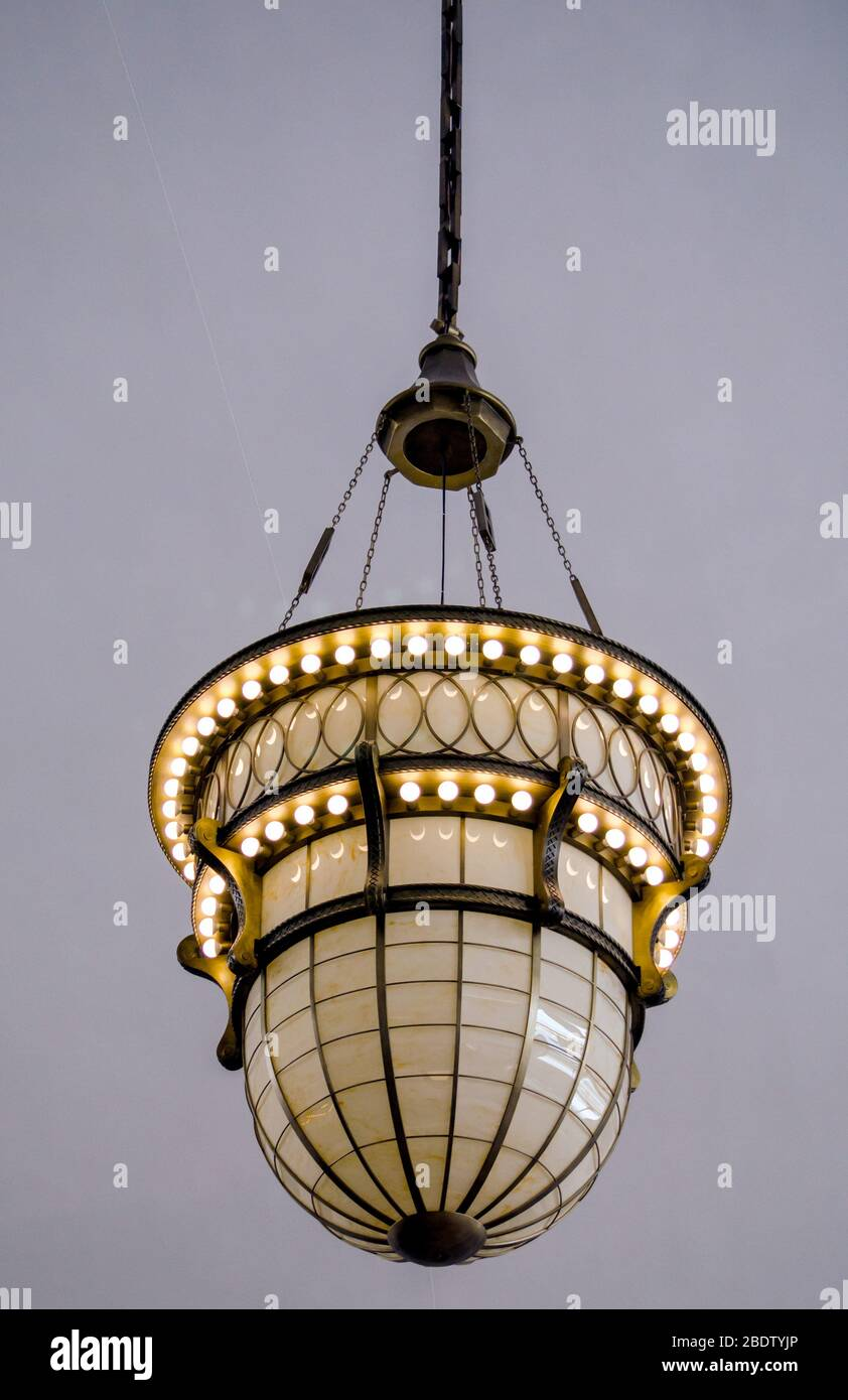 https www alamy com a beautiful antique pendant lamp hangs from a ceiling in a commercial building image352746430 html
