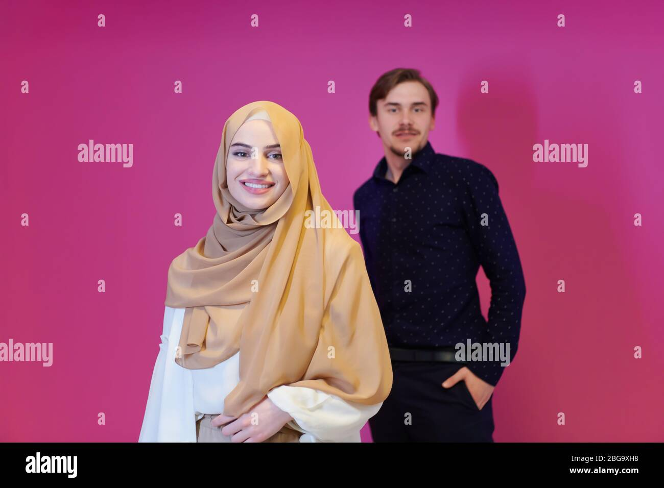 ✓ free for commercial use ✓ high quality images. Portrait Of Young Muslim Couple Woman In Fashionable Dress With Hijab Isolated On Pink Background Representing Modern Islam Fashion And Ramadan Kareem Stock Photo Alamy