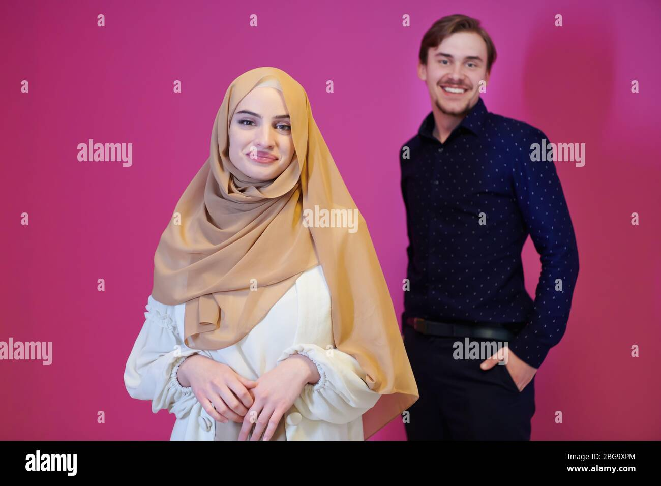 Young girls always look for style and fashion in whatever they wear. Portrait Of Young Muslim Couple Woman In Fashionable Dress With Hijab Isolated On Pink Background Representing Modern Islam Fashion And Ramadan Kareem Stock Photo Alamy