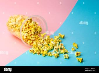 Popcorn on a colored background Minimal food concept Entertainment film and video content Aesthetics 80s and 90s concept Stock Photo Alamy