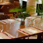 Casual Restaurant Dining Table Set Up With Dark Brown Color Theme Stock Photo Alamy