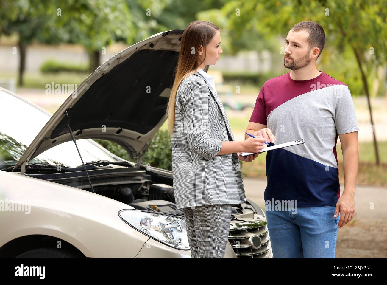 Young Man And Insurance Agent Near Damaged Car Outdoors Stock Photo Alamy
