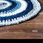 Handmade Round Wicker Rug On A Wooden Floor Cozy Home Interior Decor In Blue Gray And White Colors Stock Photo Alamy