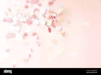 Multicolor pink gold and white confetti falling on the pastel light pink background holiday celebration backdrop with place for text Stock Photo Alamy
