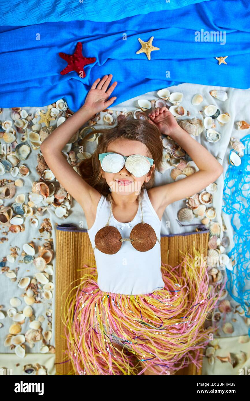 Little Girl Imitates Havaii Vacation At Home Quarantine Coronavirus Home Summer Activity Funny Happy Crazy The Child Is Lying On A Fictional Beac Stock Photo Alamy