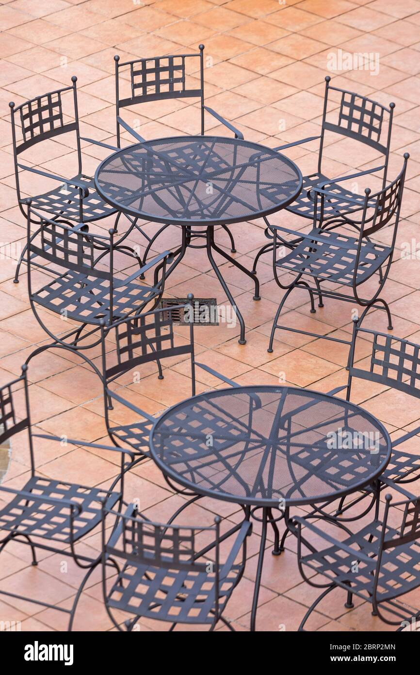https www alamy com black metal chairs and tables at patio terrace image358829541 html