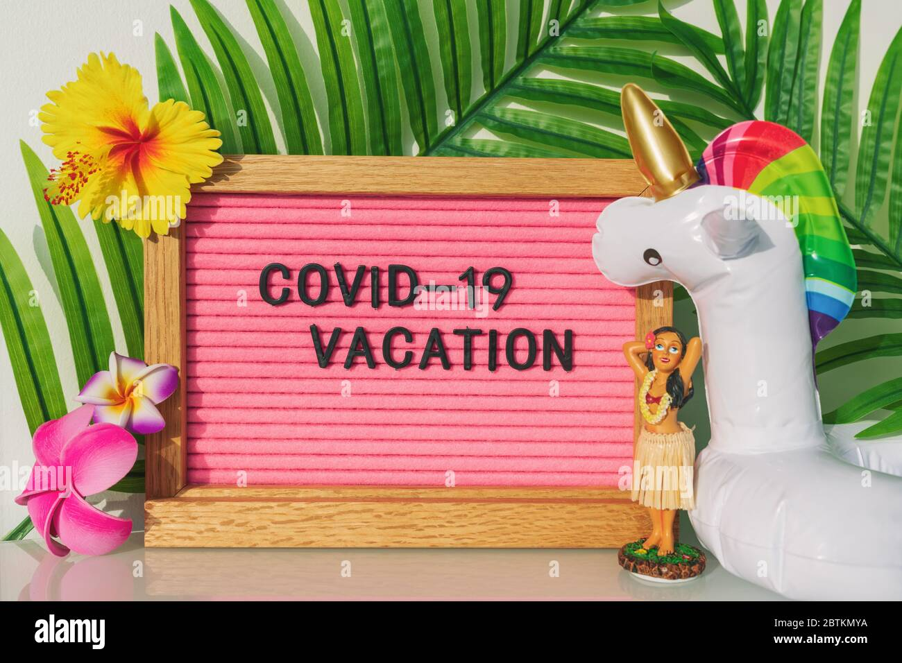 Covid 19 Vacation At Home Pink Funny Sign For Coronavirus Travel Restrictions This Summer Swimming Pool Toy Float Hula Dancer For Tropical Theme Holidays In The Backyard Stock Photo Alamy