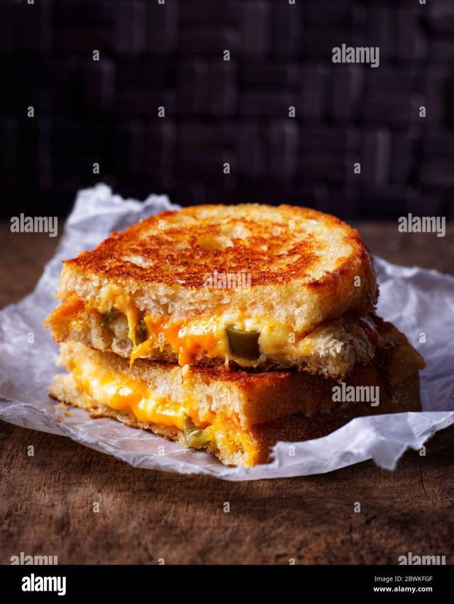 Melting Cheddar Cheese High Resolution Stock Photography and