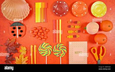 Orange aesthetic Back to School theme creative layout flat lay with school supplies candy and stationery autumn theme on textured orange background Stock Photo Alamy