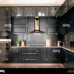 Modern Interior Design Kitchen With Black Marble Black Cabinets Dark Gold Trim And Granite Countertop 3d Render 3d Illustration Stock Photo Alamy
