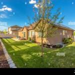 Grassy Backyard Of Home With Trees And Raised Planting Bed Along Picket Fence Stock Photo Alamy