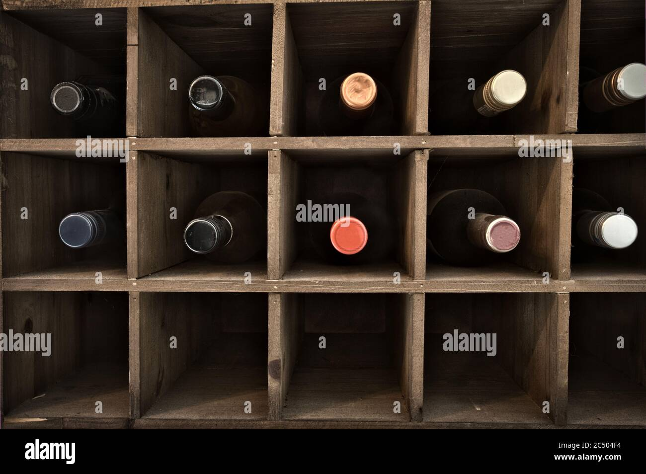 https www alamy com collection of wine in wooden wine rack in a wine cellar retro vintage wooden rack design background close up image364494568 html