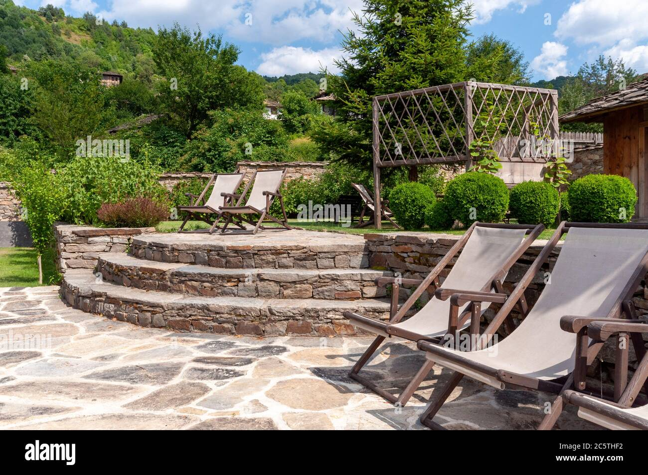 https www alamy com retro deck chairs or deckchairs with stone slabs or paving flags decking in outdoor backyard space and unique patio in old 19th century heritage house image365031606 html