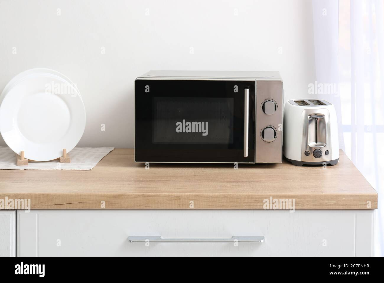 https www alamy com microwave oven with toaster on kitchen table image366220227 html