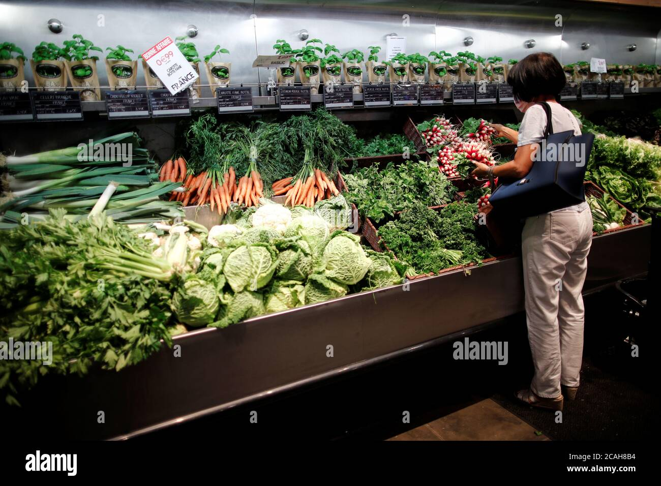 A Customer Browses Products Inside A Monoprix Supermarket Operated By Casino Group Following The Outbreak Of The Coronavirus Disease Covid 19 In Paris France August 7 2020 Reuters Benoit Tessier Stock Photo Alamy
