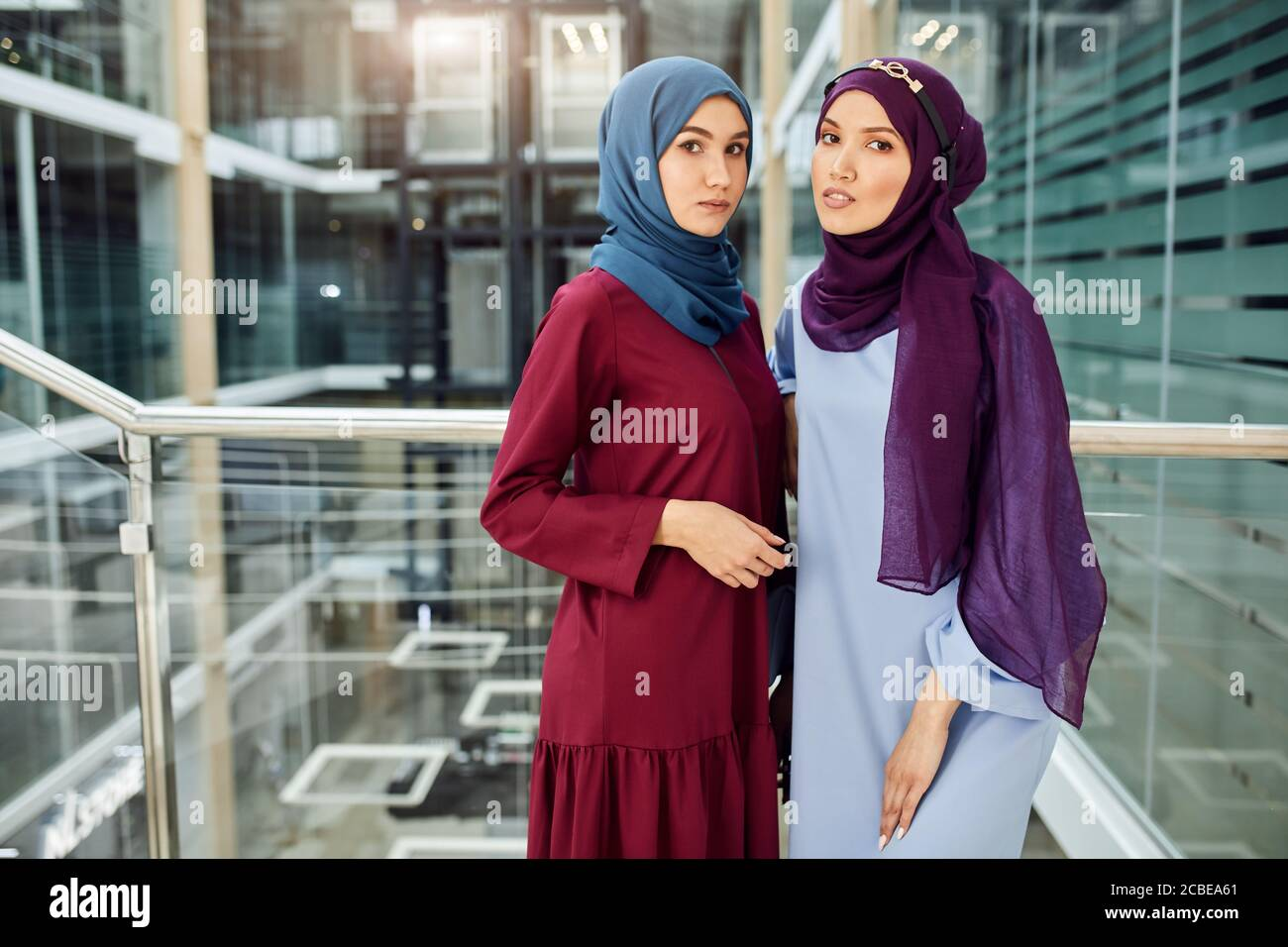 Partnerhoroskop kennen d ahsoker partner tumbrl patrol ragazza bier str. Portrait Of Two Islamic Young Women Dressed In Muslim Wear With Hijabs On Head Looking At Camera While Standing Against Glass And Steel Loft Interior Stock Photo Alamy